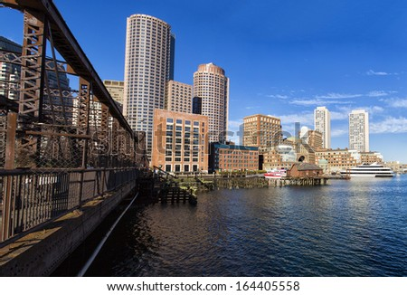 The city of Boston in Massachusetts, USA on a sunny Autumn day. This is Boston Harbor and Financial District.