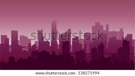 The city on the background of a sunset in red - stock photo