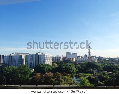 The city view from the train  contrast with blue sky color, the way out from downtown to the airport , Bangkok , Thailand    - stock photo