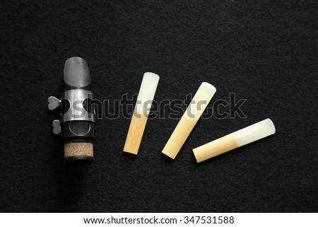 The clarinet mouthpiece on black background - stock photo