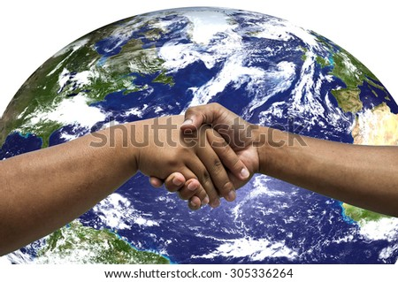 the clasped hands of a young man patterned with earth - stock photo