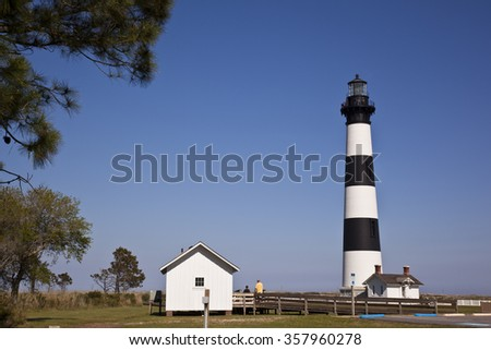 The classic Bodie Island lighthouse is a popular destination for tourists in the Outer Banks - stock photo
