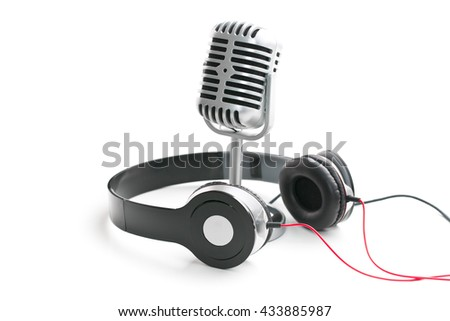 the classic vintage silver microphone and headphones