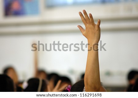The classroom, the students were very involved, actively and enthusiastically raised their hands to answer the problem posed by the teacher./hand/students - stock photo