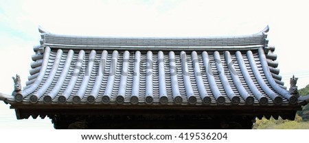 The clay roof of a Japanese temple gate - stock photo