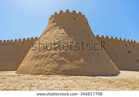 The clay tower of the medieval fortification in Khiva, Uzbekistan.