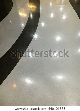 The clean floor with ceramic tiles and lighting reflection.