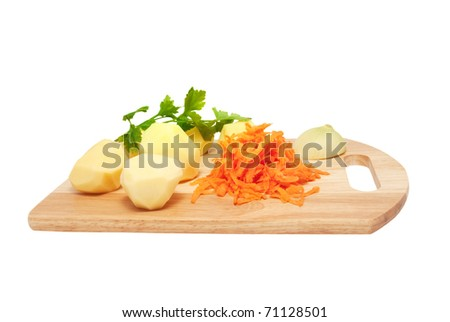 The cleared potato, the onions, grated carrots and fresh parsley on a chopping board. Components for soup on a white background - stock photo