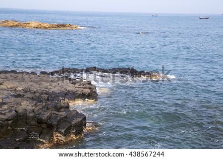 The Cliff of Stone Plates Da Dia (Ganh Da Dia) in Central Vietnam, seashore area of uniformly interlocking basalt rock columns, created from volcanic eruptions millions of years ago - stock photo