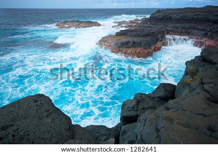 The cliffs and waves at Queen's Bath. More with keyword Series001C.