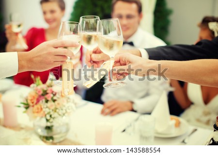 The clink of glasses. wedding reception - stock photo