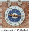 The clock at the Entrance tower of the Arsenale of Venice, Italy - stock photo