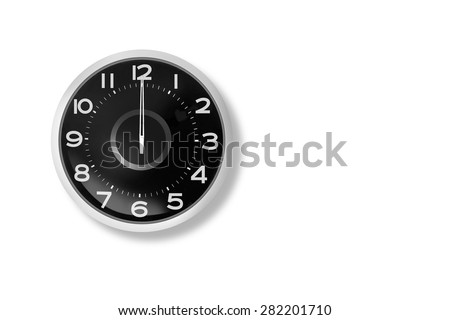 The clock shows 12:00 white background. - stock photo