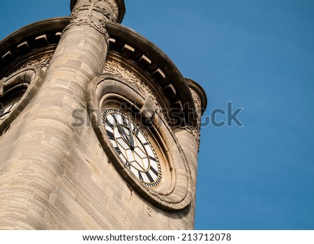 The clock tower of the Horniman Museum in Forest Hill, South London. The museum is known for its gardens and specializes in anthropology, natural history and musical instruments. - stock photo