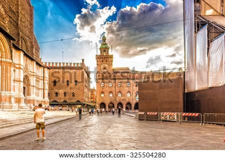 The clock tower of the  town hall from the XIV century overlooking the main square in Bologna in Northern Italy - stock photo