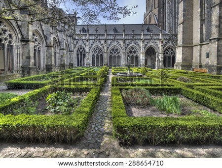 The cloister garden of the Dom Cathedral of Utrecht, Holland - stock photo