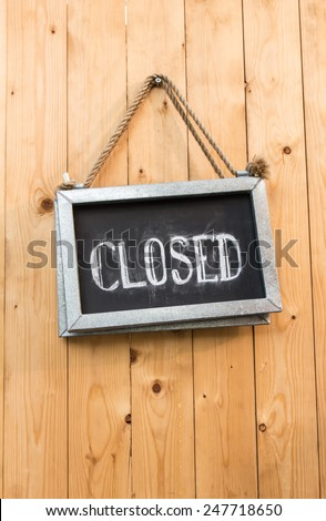 The close sign on a wooden door - stock photo