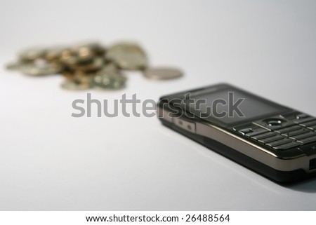The close-up of mobile phone and money (selective focus image) - stock photo