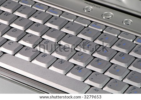 The close up of modern laptop computer's keyboard