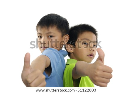 The close up portrait of little boy with big finger - stock photo