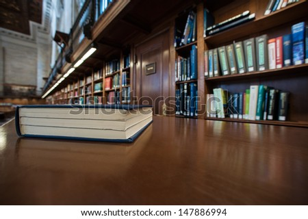 The closed book on a table in New York Public Library - stock photo