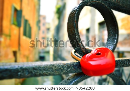 The closed red padlock in the form of heart in Venice.Italy - stock photo