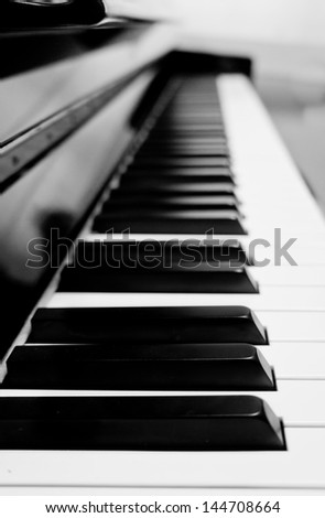 The closeup of piano key in black and white. - stock photo