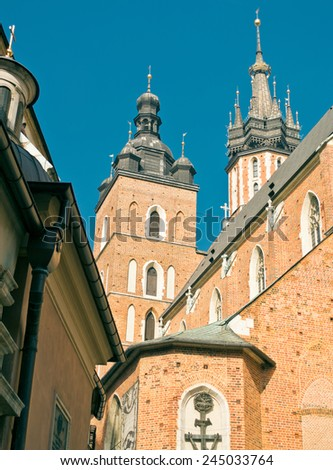 The cloth halls and the church of our lady in Krakow, Poland. - stock photo