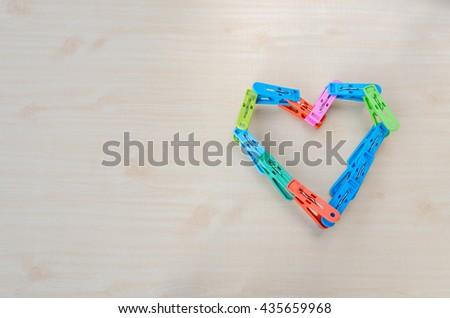 The clothespin, heart Love. - stock photo