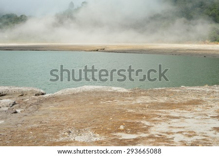 The cloud came down into the crater of Tecapa volcano and lingered by the little sulpher lagoon, near the town of Alegria in El Salvador - stock photo
