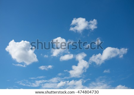 The cloud in the blue sky.