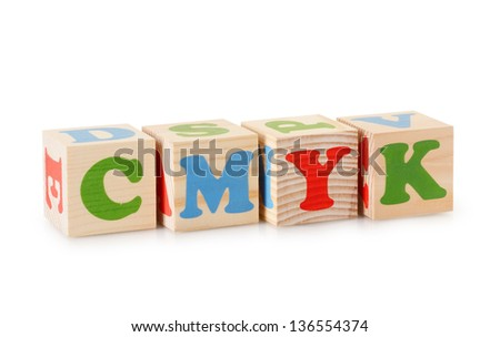 The CMYK word from wooden cubes isolated on a white background - stock photo