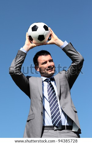 the coach with ball in blue sky in summer - stock photo