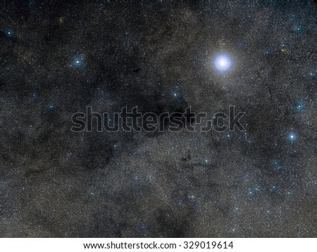 The Coalsack Dark Nebula is the most prominent dark nebula in the skies, easily visible to the naked eye. Located in the constellation Crux. Retouched image. Elements of this image furnished by NASA. - stock photo