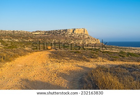 The coast is covered with a network of the bike tracks for the better possibilities to walk, ride, get enjoy from nature and active sport, Cape Greco, Cyprus. - stock photo
