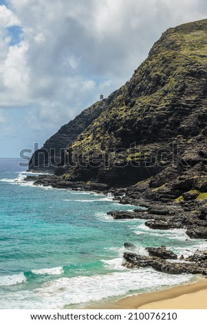 The coast of Makapuu Point with a view of Makapuu lighthouse from the beach on Windward Oahu, Hawaii