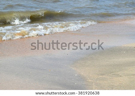The coast of the Sea of Azov. Beach Sea summer months. Evening time.