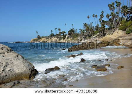 The Coastline at Laguna Beach, California, looking towards Recreation Point, with Heisler Park running along the bluff.
