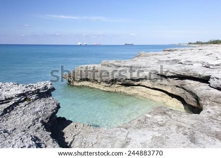 The coastline of Grand Bahama Island under erosion. - stock photo