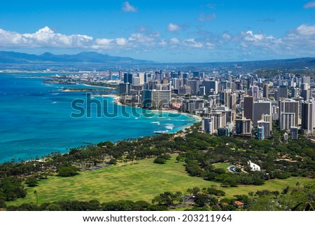 The coastline of Waikiki Beach leading into Waikiki and Honolulu in Hawaii - stock photo