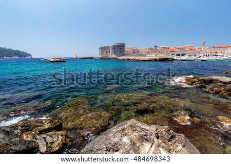 The coastline with its crystal clear sea and the Old Town of Dubrovnik in the background