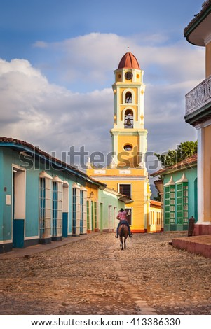 The cobblestones street that leads to  Saint Francis of Assisi Convent, Trinidad, Cuba - stock photo