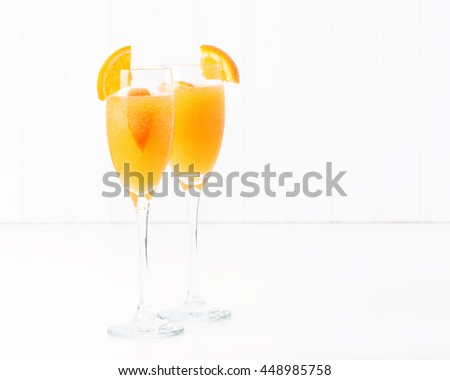 The cocktail known as a mimosa contains orange juice and champagne. - stock photo