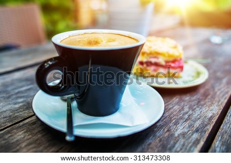 The Coffee and the Cake on the Old Wooden Table. Summertime Outdoor Coffee Break. - stock photo