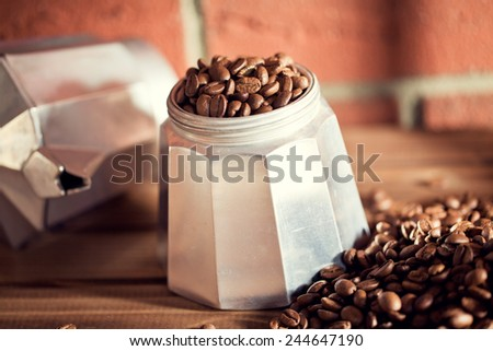 the coffee beans on wooden table - stock photo