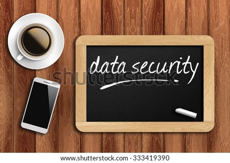 The coffee, phone  and chalkboard with word data security - stock photo