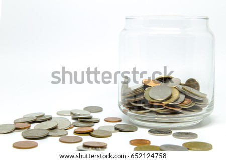 The coins in jar, save money, Thailand Baht currency.