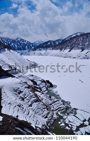 The cold weather turn the river to become white with icing surface - stock photo