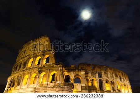 The Coliseum under the full moon, Rome, Italy - stock photo