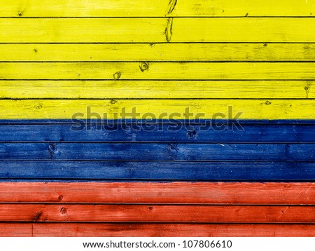The Colombian flag painted on wooden fence - stock photo